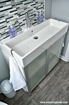 Modern Ikea double sink with towel hooks on both ends and a full width pull-out . - Modern Ikea double sink with towel hooks on both ends and a full width pull-out step stool at botto - Trough Sink Bathroom, Ikea Bathroom Vanity, Ikea Sinks, Small Bathroom Sinks, Bathroom Floor Tiles, Modern Bathroom, Family Bathroom, Bathroom Cabinets, Master Bathroom