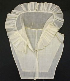 Chemisette, a womens garment, worn to cover the cleavage and fill the open part of the dress.