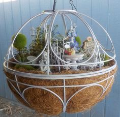 Sweet! A magical garden created from leftover hanging baskets.