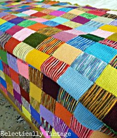 Vintage Patchwork Blanket -- no pattern, but this would be so easy to make! Garter stitch squares, alternating variegated yarns with solids, then stitched together. Happy!