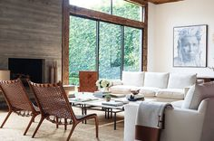 rough hewn beams frame windows, cement poured chimney/fireplace, leather & large art Jenni Kayne's Home Pictures | POPSUGAR Home