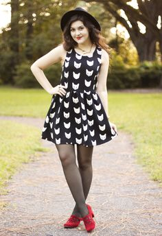 Definitely a cute transition into Fall.  Love the cat dress and the red shoes!