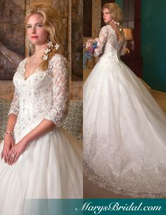 Preview of what to look for in 2014. Bridal ball gown with lace illusion sleeves and cathedral train.