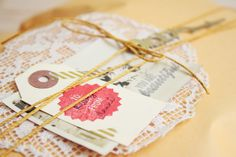 Using an envelope and spicing it up: buy twine and cute little tags.