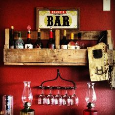 pallet piece for shelves and I love the old rake for a wine glass holder!