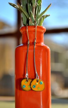 Torch Fired Enamel Earrings in Bright Orange with Glass Seed Beads. $48.00, via Etsy.