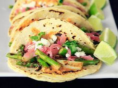 Charred Asparagus Tacos with Creamy Adobo and Pickled Red Onions // Meaty tacos are great, but who doesn't love charred sweet asparagus in the springtime? An intriguing mix of white and green charred asparagus gives complexity to these tacos.