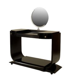"French Art Deco ebonized dressing table with ""U"" shaped sides over a platform ba"