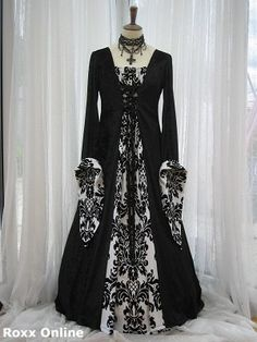 Black fleur de lys medieval dress...If I ever got married it would be in something like this! haha