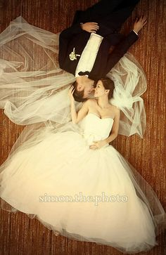 Wedding photo with bride and groom. This site has some beautiful pictures and ideas.