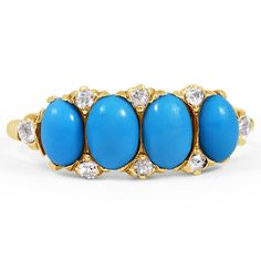Victorian era ring is decorated with four oval turquoise cabochons and complete with eight sparkling single cut diamond accents