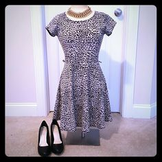 Cheetah Print Cute Dress M Super cute cheetah print dress.  Excellent condition.  Missing waist belt, so belt loops connected.  I've worn it without a belt and added a different belt to waist.  Super cute with back out detail.  Coming from a smoke free home. Dresses Mini