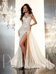 Glamorous and elegant, this Panoply 44233 Prom dress is a fashionable treat. The decadent straps flow into a bold sweetheart neckline while the bodice is designed to cater to your lovely feminine curves. Subtle yet dazzling rhinestone embellishments cover this piece in absolute glamour that will leave you sparkling all night long. The full length skirt gracefully blooms into an elongated train showcased with a thigh high leg slit to add flair and scorching style to this designer gown.