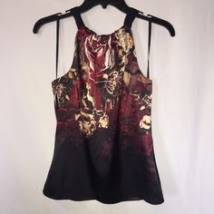 Tahari halter blouse ✨NEW✨ I have a NWT halter Tahari blouse in Petite XS. It's black with a beautiful floral design at top, it ties up behind the neck. Make me an offer! Tahari Tops Blouses
