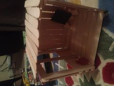 Kit's tree house made from Popsicle sticks. Have kids make and decorate the inside!