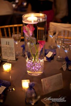 submerged flowers with floating candle