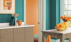 contemporary chic kitchen in teal and tangerine