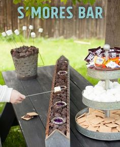 Garden party - Perfect Summer DIY for a S'mores bar on your backyard table! This is the perfect summer party show-stopper and the tabletop roasting is safer for little kids, than a fire pit. Grad Parties, Summer Parties, Camping Parties, Summer Bash, Bachelorette Parties, Teen Parties, Picnic Parties, Bachelor Parties, Holiday Parties