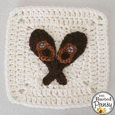 Woodland Themed Afghan – Free Crochet 'Snowshoes' Applique pattern at The Rusted Pansy.
