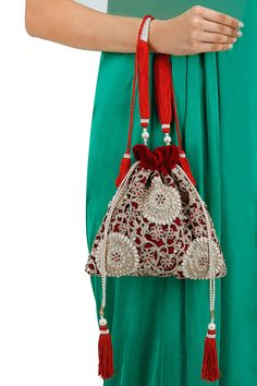 Red embroidered drawstring potli bag BY 5 ELEMENTS. Shop now at…