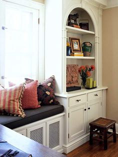 Radiator cover bench seat; cute cabinet - could work in the dining room