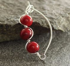 Sterling silver shawl pin or brooch with wrapped red coral beads
