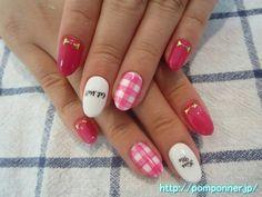 手描きの文字が可愛いピンク系ネイル  pink nail character of hand-painted cute. I drew the character gingham check, black with pink paint Shi monochromatic white. Nail the other monochromatic painted in pink, I made a ribbon studs at the base.