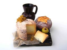 Still life with cheese by the amazing Erzsébet Bodzás of Hungarian Miniatures. Absolutely no one makes miniature cheese like this lady.