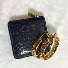 "Tory Burch Gold Large Logo Hoop Earrings Tory Burch large logo hoop earrings. T logo worked into a intricately perforated pattern. Hinge post closure. Pierced logo pattern. 1.27"" diameter. Gold. Price firm. This listing is for earrings only. 16 karat gold plated metal. Comes with box. Tory Burch Jewelry Earrings"
