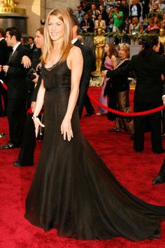 In a black Rochas gown, Bulgari jewels, and a Lana Marks alligator clutch at the 78th Annual Academy Awards in 2006. See all of Jennifer Aniston's best looks.