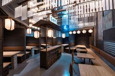 Industrial Interior Design - This Restaurant and bar goes for a warehouse chic style with metal, concrete, and wood. Inspired by Tokyo's nightlife and all the different alleys in famous Tokyo neighbourhoods, Masquespacio has designed Hikari Yakitori Bar - a Japanese restaurant in Valencia, Spain.