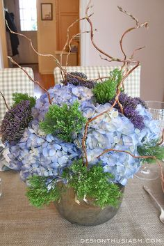 Floral Arrangement - Blues, greens and woodsy sprigs.