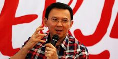 Indonesia police pursue blasphemy case against capital's Christian governor as tension simmers