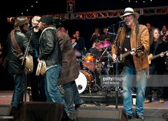 Jackson Browne, Kris Kristofferson, Eddie Vedder and Neil Young (R) perform at the 24th Annual Bridge School Benefit concert at Shoreline Amphitheatre on October 23, 2010 in Mountain View, California.