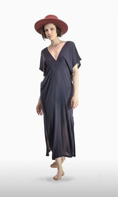 The Double V in Navy Rayon | A JOSA tulum favorite! A sexy plunging neckline is echoed in the back. Short kimono-style sleeves and a maxi length skirt add drama and sophistication.