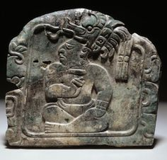 Pendant depicting an enthroned lord. Date: c. A.D. 600-900. Jadeite (?). Maya culture