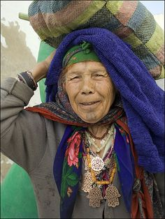 """Kairouan, the fourth holiest site of Islam, was a fantastically peaceful place to explore. This lady was very proud to show us here """"Hand of Fatima"""" jewelry and ginger hair."""