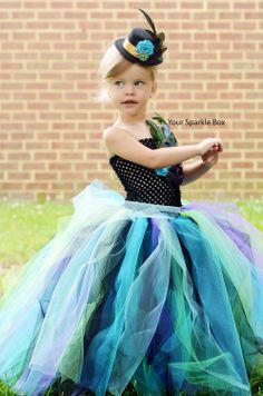 Peacock tutu dress.  I could do a lot of themes, make her the Queen of Hearts, or the white queen....so many possibilities!