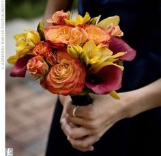 Jami's two sisters held fall-friendly bouquets of circus roses, mambo spray roses, yellow freesia, mini calla lilies and gold cymbidium orchids. The bright hues stood out against their navy dresses.