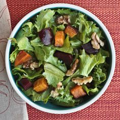 Winter greens with roasted butternut squash, beets and walnuts. The perfect Thanksgiving salad! Vegan and gluten-free.