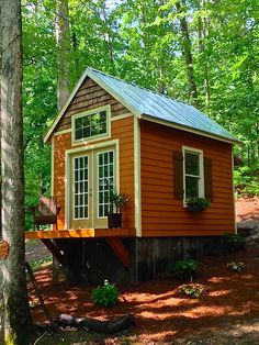 """The view from the porch of our house, looking up at the guest house.  I can guarantee a nicely built tiny home, but I can't guarantee our view!  Yes, a railing will go around the porch shortly.  I'm 6'2"""", and I have roughly five inches to spare under the loft. The walls  are 9 feet, giv"""