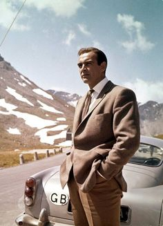 Cars: Sean Connery in Goldfinger. Goldfinger – Aston Martin Not the clearest shot of the but you know it anyway. Sean Connery, as James Bond, unleashed the tyre slashers and ejector seat in the 1964 movie Sean Connery James Bond, James Bond Goldfinger, Aston Martin Db5, Martin Car, I Movie, Movie Stars, Tv Star, Cinema Tv, Classic Hollywood