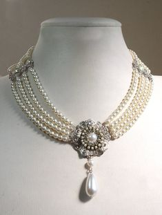 Beautiful Bridal choker features four strands of small white Ivory pearls with a silver flower filigree set with Ivory pearls and a drop pearl is dangle below Between the lines Royal Jewelry, Pearl Jewelry, Beaded Jewelry, Beaded Necklace, Silver Jewelry, Onyx Necklace, Gold Jewellery, Pearl Necklace Designs, Pearl Choker