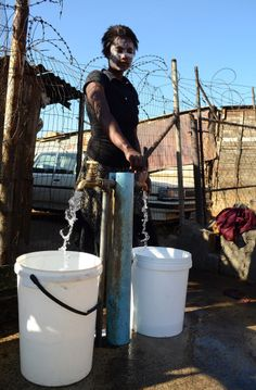 Makhosi Jonase says she is happy that there is clean running water in the camp in Kliptown. Picture: Timothy Bernard