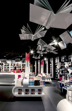 Tjep. was responsible for the interior design of the AKO flagship store at Schiphol Airport. For this project we were inspired entirely, and on nothing else but books, from the book displays, to the flying book light fixtures and the checkout counter reminiscent of a stack of books.