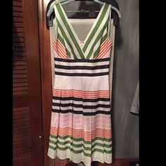 "Kay Unger New York A-line dress  Kay Unger A-line dress purchased a few years ago from Bloomingdales. Worn 2x!! Beautiful stripes: black, green, pink, orange. Classy dress in great condition. 40""L ; 13"" across waist. Offers welcome!!  more pictures to come!! Kay Unger Dresses"