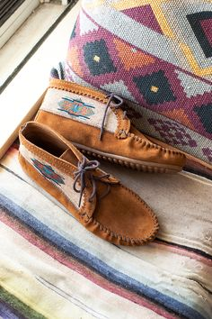 Inspired by spirit of the Southwest, beautifully woven fabric complements the soft and supple suede of this one-of-a-kind ankle boot.