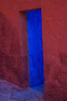 The blue door in the red wall Santa Catalina Monastery #peru -#tmophoto