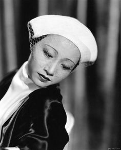 anna may wong wearing a white hat with veil | 1934 | #vintage #1930s #fashion