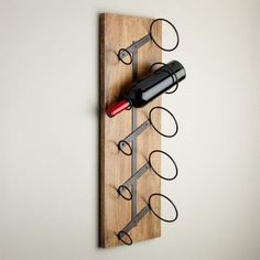 Crafted of mango wood with stylish metal holders, our Woodland Wall Wine Rack is both handy storage solution and attractive wall art. It holds up to five bottles of wine securely either horizontally or vertically. Wine Rack Design, Rustic Wine Racks, Metal Wine Racks, Wine Rack Wall, Wall Wine Holder, Wine Wall Art, Wine Display, Bottle Wall, Creation Deco